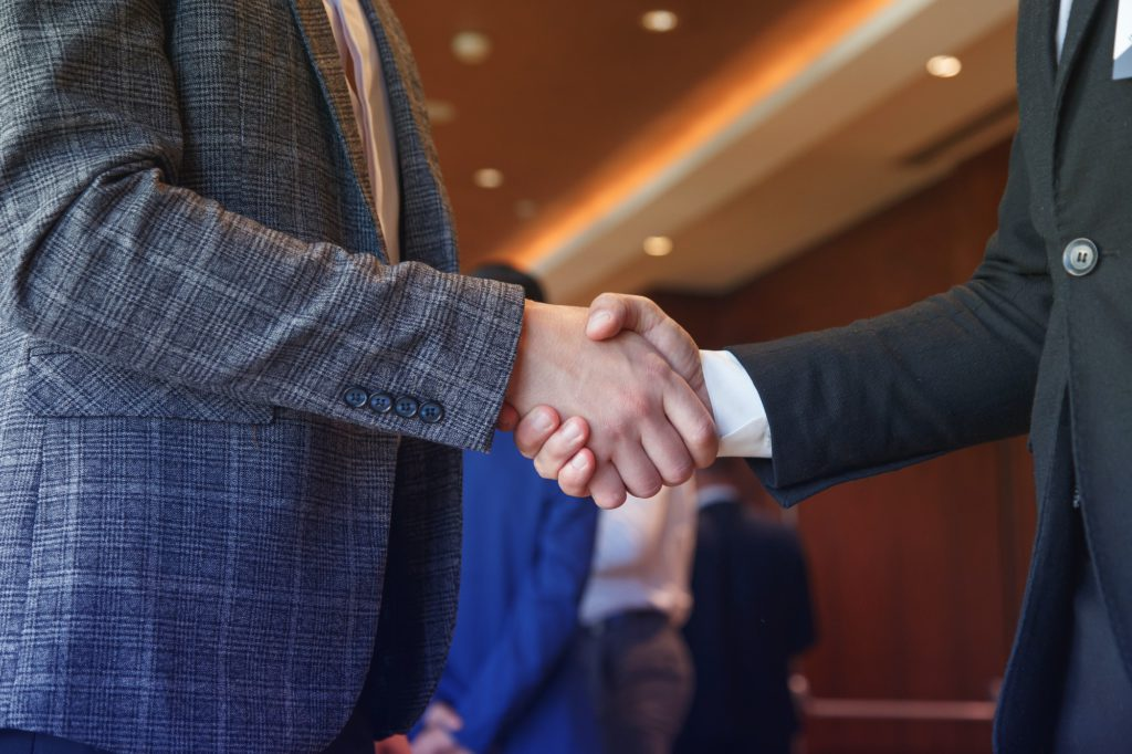 Businessmen shake hands